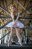picture of tutu  - Graceful ballerina in white tutu in the industrial background of the bridge - JPG