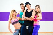 stock photo of zumba  - Man posing with woman in zumba dance school - JPG