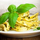 pic of pesto sauce  - Cooked homemade tagliatelle pasta with green pesto sauce - JPG