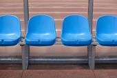 stock photo of substitutes  - Stadium seats for substitutes and trainer in a football ground - JPG