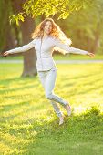 image of hair blowing  - Romantic girl outdoors enjoying nature Beautiful Model in Casual jeans in sun light Long healthy Hair Blowing in Wind Backlit Warm Color Tones Sunshine woman  Sunny Summer Day Autumn Summertime Glow - JPG