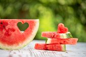 picture of watermelon slices  - decorated watermelon slices with heart shape  - JPG
