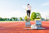 stock photo of sprinters  - Closeup of a starting block - JPG