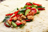 stock photo of shawarma  - Traditional unfolded shawarma with chicken and vegetables just before wrapping - JPG
