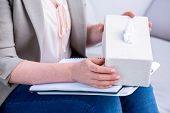picture of tissue box  - Businesswoman holding paper tissue box in office - JPG