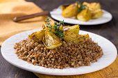 image of buckwheat  - Buckwheat porridge with baked onions on a wooden table - JPG