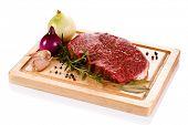 stock photo of cutting board  - Fresh raw beef on cutting board on white background  - JPG