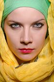 image of burqa  - Serious woman wearing colourful headscarf - JPG