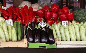 image of stall  - Vegetables piles inside crates on market stall - JPG
