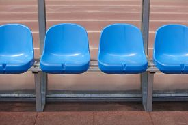 picture of substitutes  - Stadium seats for substitutes and trainer in a football ground - JPG