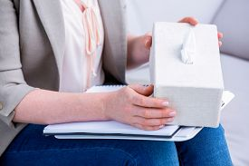 pic of tissue box  - Businesswoman holding paper tissue box in office - JPG