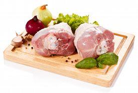 picture of turkey-hen  - Raw turkey legs on cutting board  - JPG
