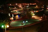 foto of miniature golf  - a miniature golf course Lit up and beautiful - JPG