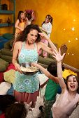 stock photo of misbehaving  - Misbehaving kids throwing popcorn with an unhappy babysitter - JPG