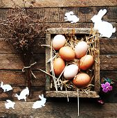 Easter Composition With Chicken Eggs On The Warm Wooden Backgrou poster