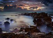 Dramatic Ocean Sea With Dark Purple Clouds
