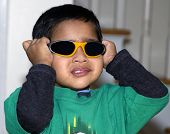 picture of rutin  - An young asian kid having fun with his goggles - JPG