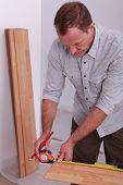 cabinetmaker taking measurements
