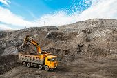 Large Quarry Dump Truck. Loading The Rock In The Dumper. Loading Coal Into Body Work Truck. Mining T poster