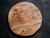 Round Wooden Tray Or Cutting Board On Black Table. Top View Of Empty Kitchen Trendy Rustic Wooden Tr poster