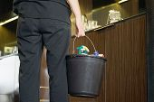 Housekeeper In Shock, Standing In A Dirty Hotel Room With A Bucket And Washing Facilities. Housekeep poster