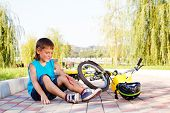 stock photo of scabs  - Unhappy kid who has fallen off the bike - JPG