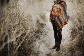Hipster Traveler Girl In Gypsy Look In Desert Nature.  Artistic Photo Of Young Hipster Traveler Girl poster