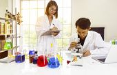 Asian Scientists Or Researcher Are Study And Research With Siamese Fighting Fish Or Betta Splendens  poster