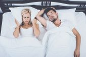 Top View Of Man Snoring Loudly Wife Blocks Ears. Snore Concept. Snore, Sleep, Apnea, Couple In Love, poster