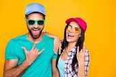 Portrait Of Funky Crazy Students In Modern Eyeglasses Gesturing Rock And Roll Symbols Isolated On Vi poster