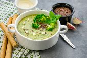 Vegan Broccoli Cream Soup On A Gray Stone Background, Vegetable Soup Puree In A White Plate. poster