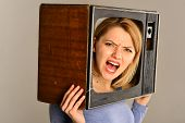 Television Set. Television Set On Head Of Angry Woman. Woman Hold Television Set In Hands. Televisio poster
