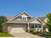 Luxury Family House With Wide Concrete Driveway, Double Garage And Landscaped Front Yard. Residentia poster