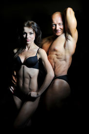 image of weight-lifting  - man and a woman trained in the gym - JPG