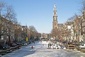 Winter at the Prinsengracht with the Westerkerk in Amsterdam the Netherlands
