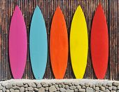 Five colored surfboards