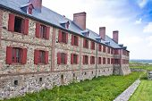 stock photo of acadian  - Military barracks at the reconstructed Fortress of Louisbourg  - JPG