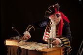 Colorful Old Pirate Captain With Pewter Mug And Treasure Map