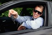 Young Man  Buying New Car, Smiling