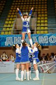 MOSCOW - MAR 24:  Girl from cheerleaders team Jam performs stunt at Championship and Contests of Mos