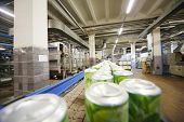 MOSCOW - MAY 16: Cans with drink mojito on conveyor in Ochakovo factory, on May 16, 2012 in Moscow,