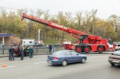MOSCOW - OCT 9: Large red rescue vehicle helps injured in car crash on October 9, 2011 in Moscow, Ru