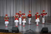 MOSCOW - APR 4: Children dressed as hussars on stage  performs on stage on District Competition Crys