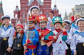 MOSCOW - MAY 27: Children dressed in costumes on Red Square during 8-th sports forum GTO, May 27, 20