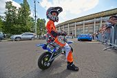 MOSCOW - JUN 30: Juvenile participant of Speedfest at Luzhniki in motorcyclist outfit, June 30, 2012