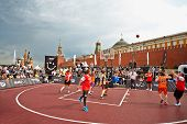 MOSCOW - MAY 27: People watch basketball game during Dudu Streetbasket fest on Red Square, May 27, 2