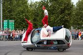 MOSCOW - JUN 30: Seven members from stuntmen team Avtorodeo Togliatti Trick go by car on two wheels