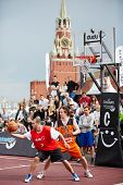 MOSCOW - MAY 27: People watch game during Dudu Streetbasket fest on Red Square, May 27, 2012, Moscow
