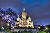 PARIS APRIL 18: Sacre Coeur Basilica at night on April 18, 2013 in Paris, France. Sacre Coeur is one