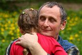 image of granddaughters  - Grandfather hugging granddaughter with his eyes closed - JPG